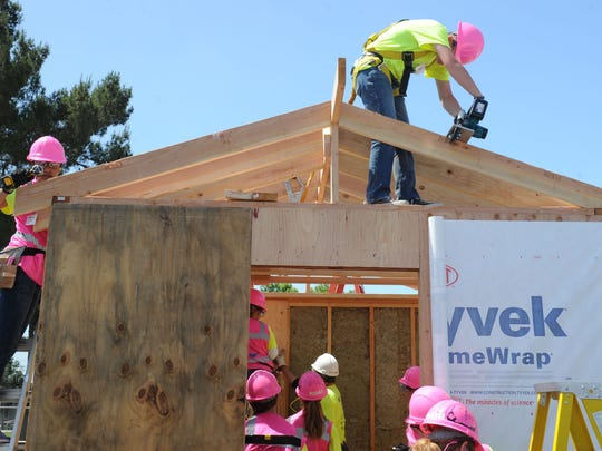 Girls work on the tiny house at the Ventura County Office of Education's Career Education Center in Camarillo. The girls were learning construction skills while building a tiny house that will be installed at River Haven, a camp for formerly homeless people in Ventura.