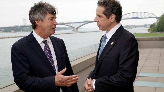 Gov. Andrew Cuomo, right, talks with Ambassador Gary Doer of Canada after announcing a Peace Bridge deal in Buffalo in 2013. The Peace Bridge crossing was one of the experimental sites for a pre-clearance program that was signed Monday.