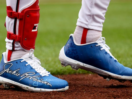 Washington Nationals' Bryce Harper wears shoes with Jackie Robinson's signature for Jackie Robinson Day during a baseball game against the Colorado Rockies at Nationals Park, Sunday, April 15, 2018, in Washington. (AP Photo/Andrew Harnik)