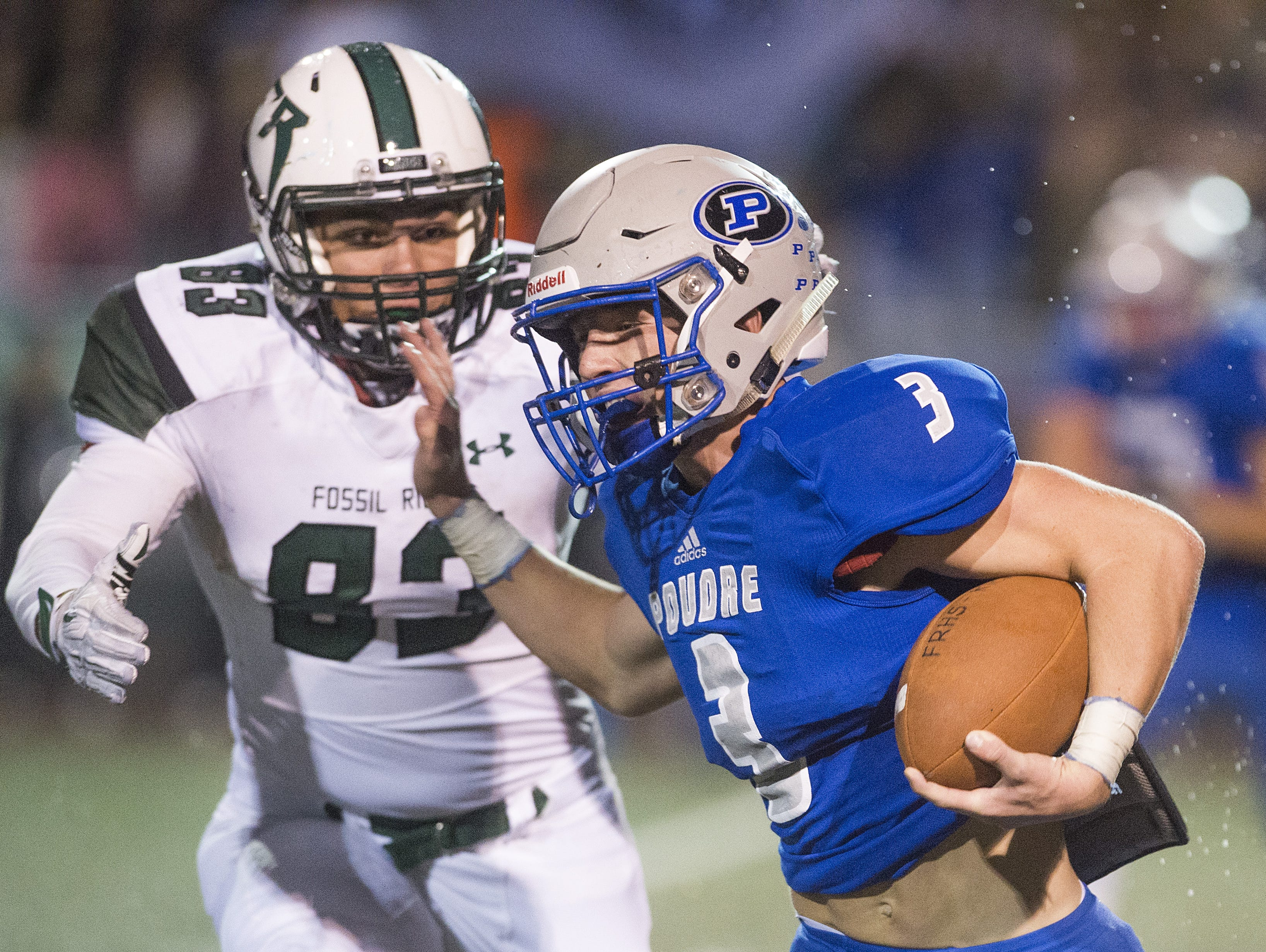 Dylan Marsh of Poudre High School tries to evade Fossil Ridge's Owen Arkin during a game last season. The two teams meet again at 7 p.m. Friday.