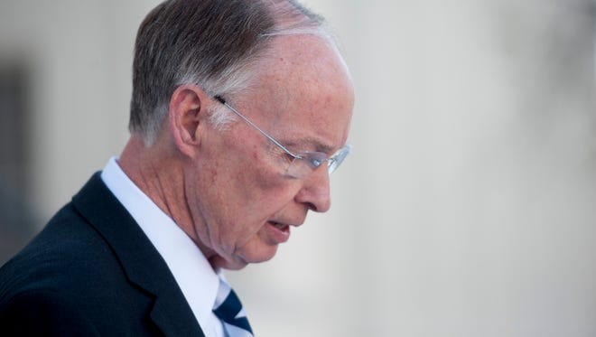 Governor Robert Bentley reiterates that he is not resigning during a news conference on the capitol steps in Montgomery, Ala., on Friday April 7, 2017.