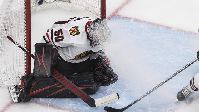 Chicago Blackhawks goalie Corey Crawford is sprayed with ice shavings during the second period in Game 5 of the team's first-round playoff series against the Vegas Golden Knights on Tuesday, in Edmonton, Alberta.