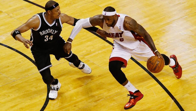 Miami's LeBron James, right, drives to the basket as Brooklyn's Paul Pierce defends in the second half of Game 5 of the second round on Wednesday.