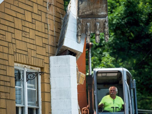 Jeremy Long — Lebanon Daily News Using an excavator, Penn Earthworks tears down the house at 315 S. Lancaster St., Annville Township. The house was damaged in 2011.
