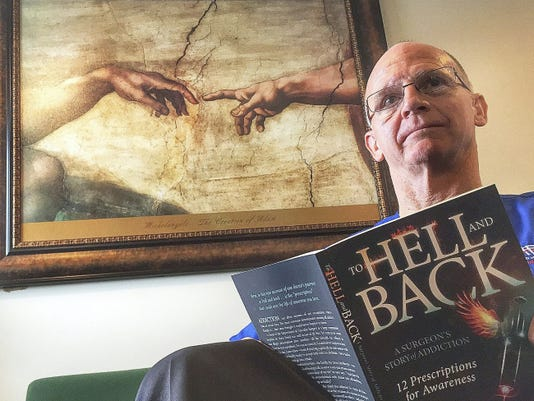 """Dr. Steven Heird reads from his book """"To Hell and Back."""" The book tells of his addiction and recovery. Heird tells his story in a video at yorkdispatch.com."""
