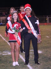 Cobre High School Homecming queen Chambrae Dominguez stands next to her king Marcus Salas during the halftime festivities of the Homecoming football game between Cobre and Santa Teresa on Friday.