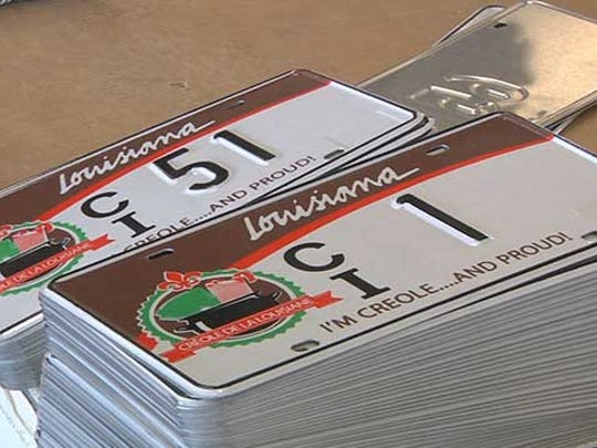 The first batch of license plates reading 'I'm Creole... and proud' are being produced at the Louisiana State Penitentiary.