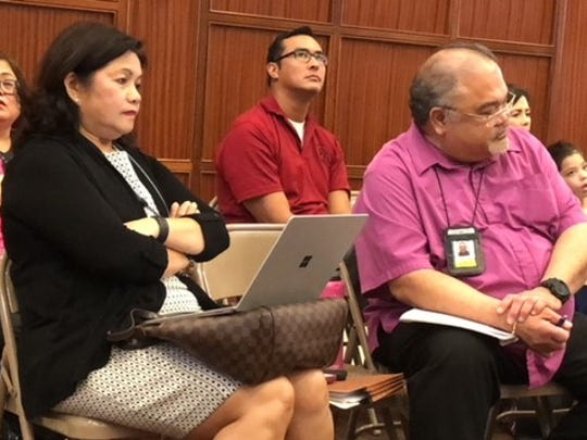 Guam Memorial Hospital Chief Financial Officer Benita Manglona, right, and GMH Administrator PeterJohn Camacho look on as Dr. Kozue Shimabukuro, not in photo, testifies before senators about alleged mismanagement and other issues at the hospital.
