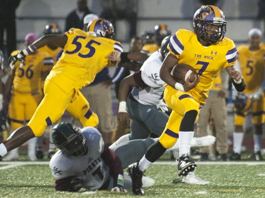 Camden running back Najyere Edwards looks for running room during the first half of Friday's game against Cedar Creek.