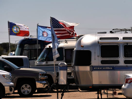 Flags flutter in the wind Tuesday at the Taylor County Expo Center. The Wally Byam Caravan Club, International Region 9 Rally will have about 60 Airstream enthusiasts all week at the fairgrounds.