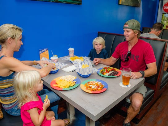 Katie and Jimmy Moren, owners of nearby Locals Surf