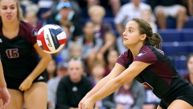 London's Emilie Cagle sets the ball against Tuloso-Midway during the CCISD McDonald's SpikeFest Championship game on Saturday, Aug. 12, 2017, at Veterans Memorial High School in Corpus Christi.