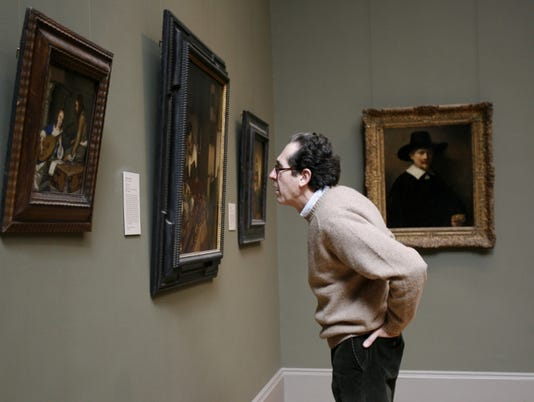 Take your picture with a picture on Museum Selfie Day