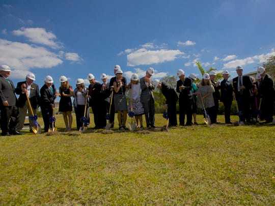 School administrators break ground at the site of Ave Maria University's future academic building on November 11th, 2016.