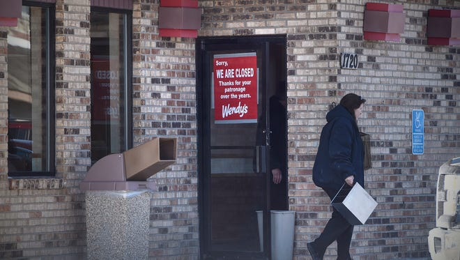 A sign announces the closing of the Wendy's restaurant Tuesday, March 14, at 1720 St. Germain St. in St. Cloud.