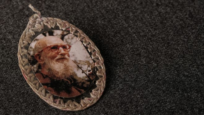 Legions of Detroit-area Catholics keep Solanus Casey badges. The badges are oval plastic badges encasing a photo of Father Solanus Casey and a pin-prick of brown cloth, held together by an edging of embroidery