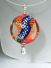 Contemporary glass artist Astrid Riedel will share her techniques at Rochester's Studio 34 through July 22. This item is handblown glass.