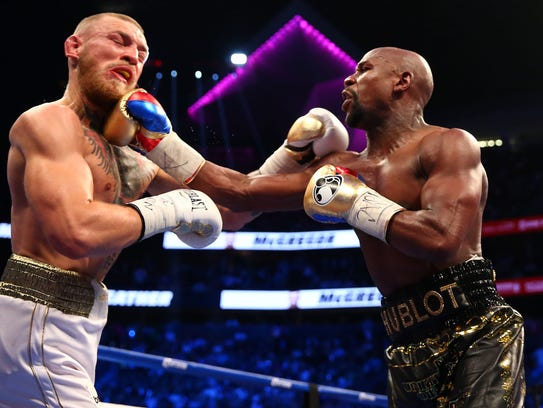 Aug 26, 2017: Floyd Mayweather Jr. lands a hit against