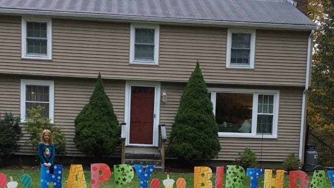 Maggie McVoy, seen here outside her home in Topsfield, just turned 7.
