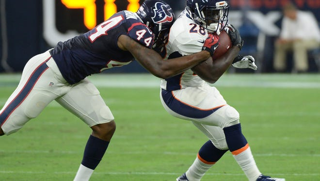 Denver Broncos' Montee Ball (28) is hit by Houston Texans' Carlos Thompson (44) during the first half of an NFL preseason football game, Saturday, Aug. 22, 2015, in Houston. (AP Photo/George Bridges)