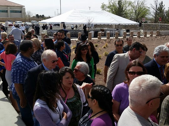 Doña Ana County residents and dignitaries wait to enter a new 911 call center on March 4 for their first glimpse of the nearly finished facility's interior.