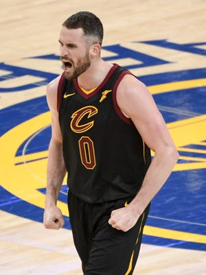 Cleveland Cavaliers center Kevin Love celebrates during the fourth quarter in Game 1 of the 2018 NBA Finals.