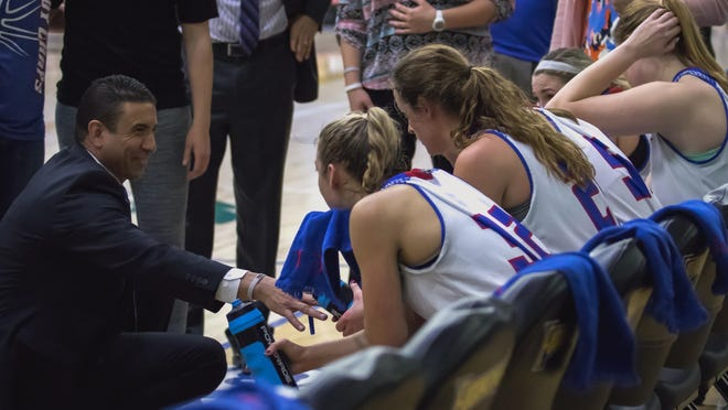 Lubbock Christian women's basketball coach coach Steve Gomez talks with his players during a timeout in a Heartland Conference game Feb. 15, 2018 against Newman at the RIP Griffin Center.
