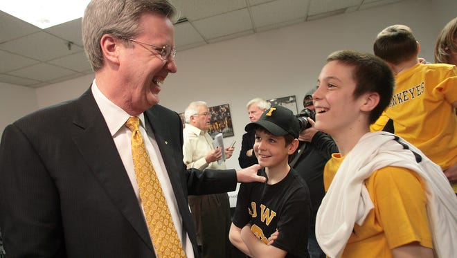 New Iowa basketball coach Fran McCaffery greets shares a laugh with his sons Connor, McCaffery, 11, right, and Patrick McCaffery, 10, center, after a press conference introducing McCaffery, Monday, March 29, 2010, at Carver-Hawkeye Arena, in Iowa City, Iowa.