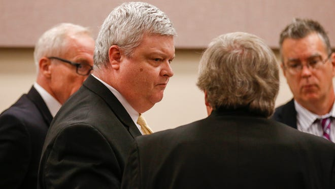 Craig Wood talks with his lawyers after he is found guilty of first-degree murder for the Hailey Owens killing.