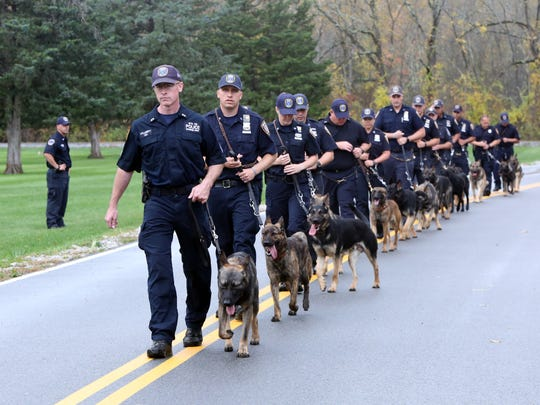 A recruit class of 13 officer and dog teams train at