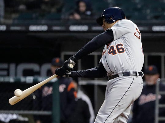 Detroit Tigers' Jeimer Candelario hits an RBI single against the Chicago White Sox during the 10th inning of a baseball game Thursday, April 5, 2018, in Chicago. The Tigers won 9-7. (AP Photo/Nam Y. Huh)
