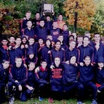 The Northville boys cross country team celebrates after winning the Kensington Conference title.