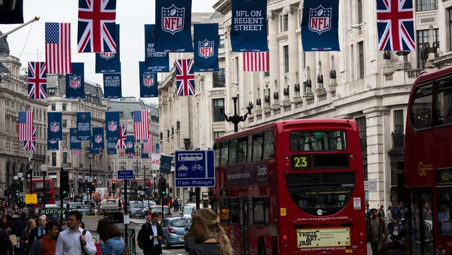 Flags hang draped across Regent Street promoting the forthcoming NFL game between the Steelers and Vikings in London on Sept. 23, 2013.