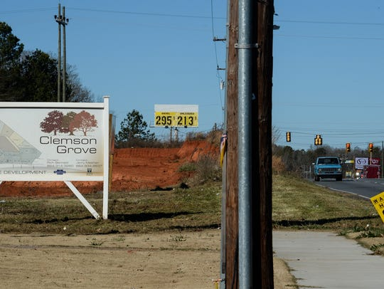 A sign for Clemson Grove mixed use development, near
