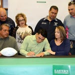 Dante Urrea signed a national letter of intent to attend Eastern New Mexico University in Portales and play football. On hand for the signing were, standing from left, DHS Head Football Coach Fernie Holguin, DHS Financial Aid Adviser  Yvonne Jasso Perales, DHS Athletic/Activities Director Bernie Chavez and Assistant Wildcat Football Coach Richard Perales. Seated are Dante's father, Juan, and his mother, Dawn.