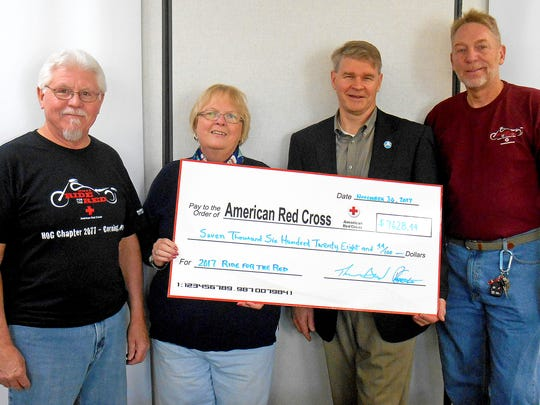 The Arkport-Corning Harley Owners Group recently presented the American Red Cross with a check for more than $7,000. From left are Tom Doud of the H.O.G. chapter, Services to the Armed Forces volunteer Linda Conway, Red Cross Executive Director Brian McConnell, and H.O.G. member Paul Simonson.