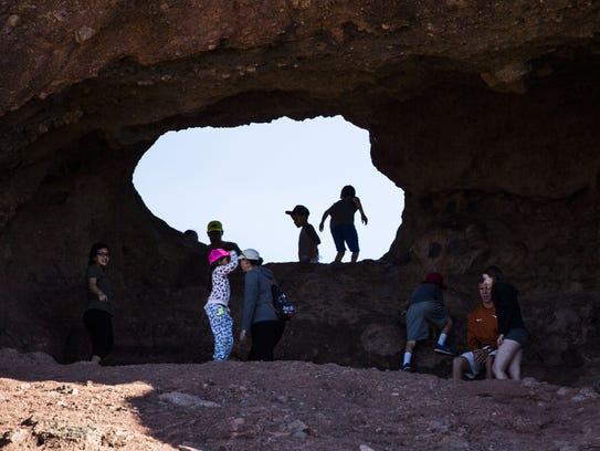 People explore Hole in the Rock at Papago Park in Phoenix,
