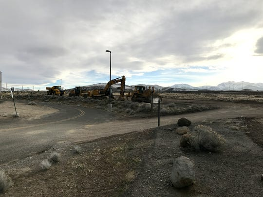 Construction equipment are lined up at the Summit Club Apartments site near The Summit Reno mall.