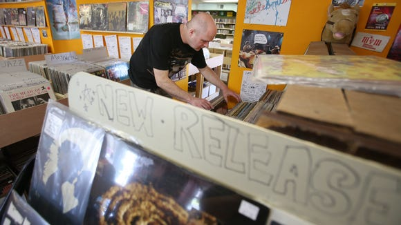 A customer hunts through LPs at Jupiter Records near Arden.