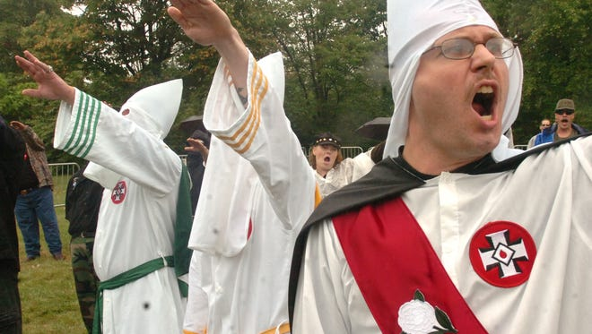 The Mason-Dixon Line and Gettyburg with its nearby battlefield have served as two magnets for Klan activity for years. Here, James Lewis, right, of Wrightsville, joins other members of the Ku Klux Klan in saluting during a 2006 rally in Gettysburg.