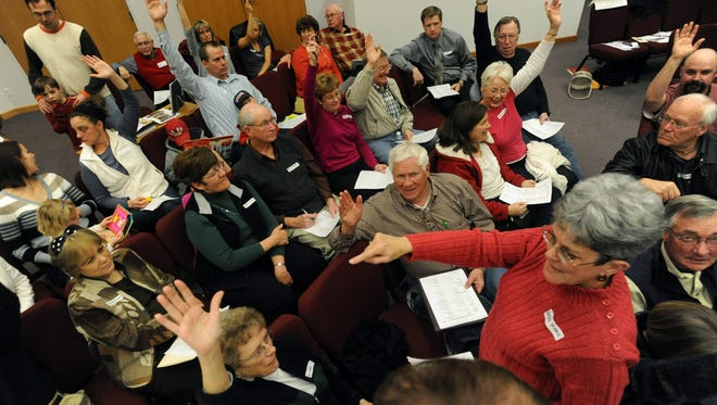 Barbara Frease of Precinct 329, right, counts votes as her fellow precinct members take a poll during the Republican Caucus at the Heart of the Rockies church in southeast Fort Collins in 2010. Republican and Democratic caucuses will be held across Colorado on Tuesday