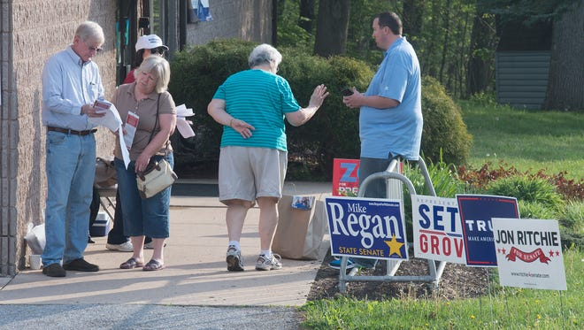 Voters arrive at the Dover Township Precinct 3 polling place at Bob Hoffman YMCA, one of the places where voters chose between four candidates to replace state Sen. Pat Vance.