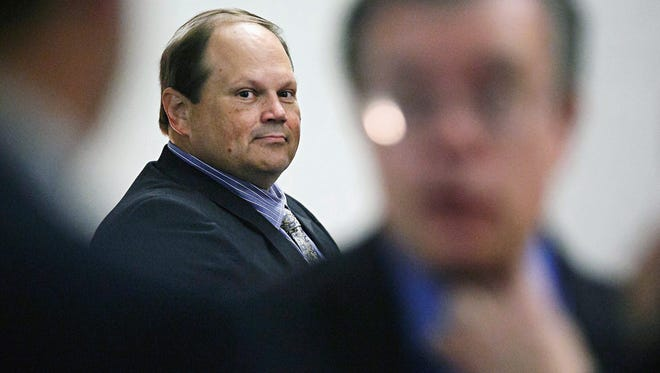 In this July 15, 2015 file photo, Eddie Tipton, former security director of the Multi-State Lottery Association, looks toward his lawyers before the start of his trial in Des Moines, Iowa. Tipton is charged with installing software on lotteries' random number generators that allowed him to predict winning numbers on three days of the year.