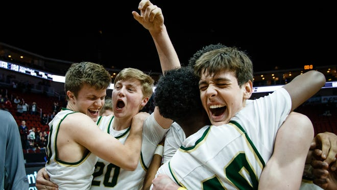Iowa City West players celebrate after defeating Valley to win the 4A state basketball championship 64-50 on Saturday, March 11, 2017, in Des Moines.