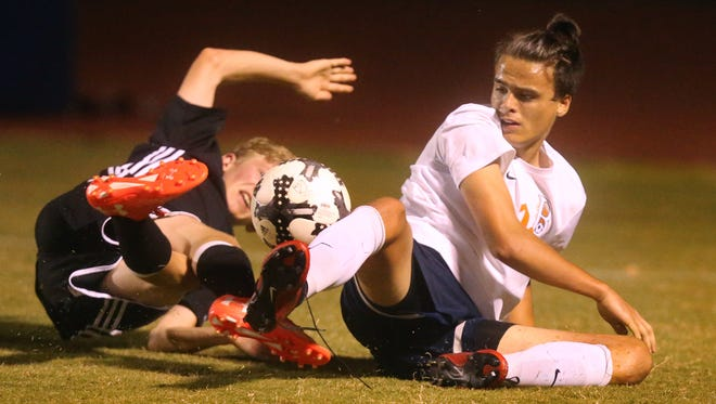 Blackman's Luke Buckley slides into a Tullahoma defender during last year's region tournament. Buckley is one of the key returnees for the Blaze, who reached the Class AAA sectional last season.