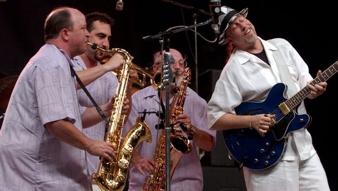 Stacy Mitchhart, right, and his band play the blues during the Handy Fest Friday night, June 18, 2004. (Gleaner photo by Darrin Phegley)