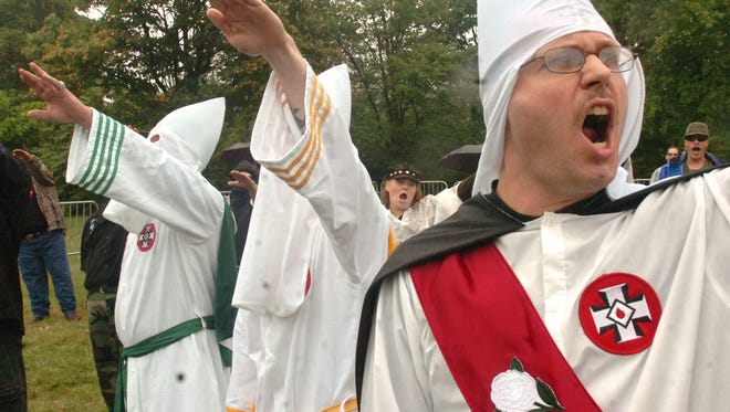 James Lewis, right, of Wrightsville, joins other members of the Ku Klux Klan during a 2006 rally in Gettysburg.