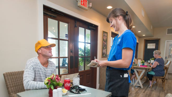Server Natalie Wartner takes Nick Cugini's order at Norma's at duh in Pensacola on Tuesday, Oct. 10, 2017. Cugini, who has been coming to Norma's every day for lunch for the past two years, said he is sad to hear the restaurant will close permanently on Friday, Oct. 20, 2017.