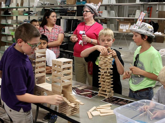 Children stack building blocks at the the grand opening of STEAM Central March 23, 2017, at Stephen's Cental Library.
