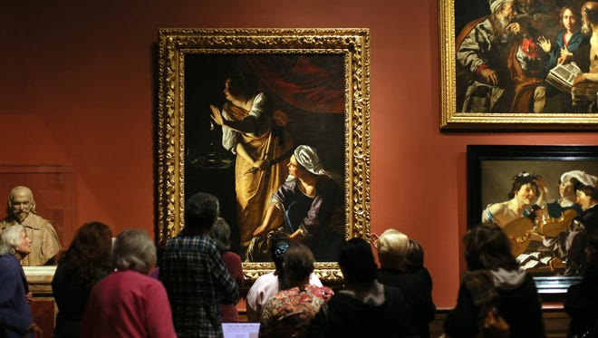 Attendees at the Detroit Institute of Arts view some of the museum's masterpieces. The institute still must raise roughly $350 million for endowment and annual operations in the next eight years — in addition to the $13 million needed to meet its $100-million commitment to the grand bargain.
